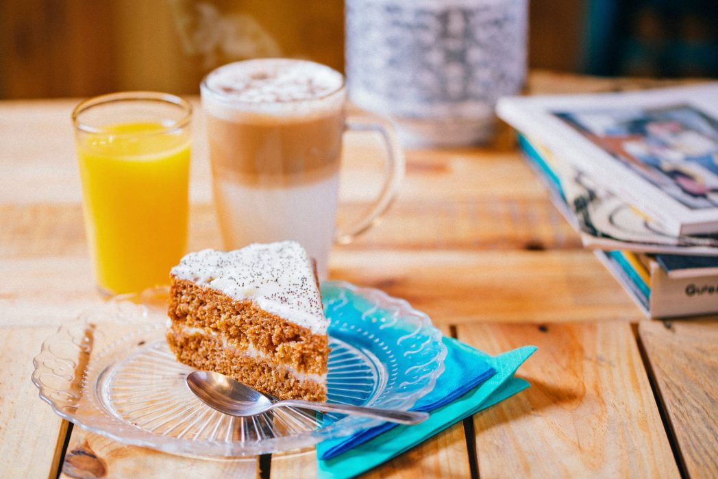 Delicious piece of Carrot cake with coffee and Orange Juice for breakfast at La Marmota