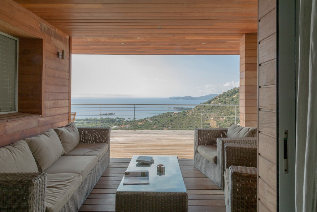 Luxury Real Estate photography in South Corsica on the luminous terrace with view on the sea and mountains